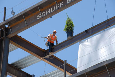 Final steel beam is placed at St. Jude Medical Center's new patient tower.