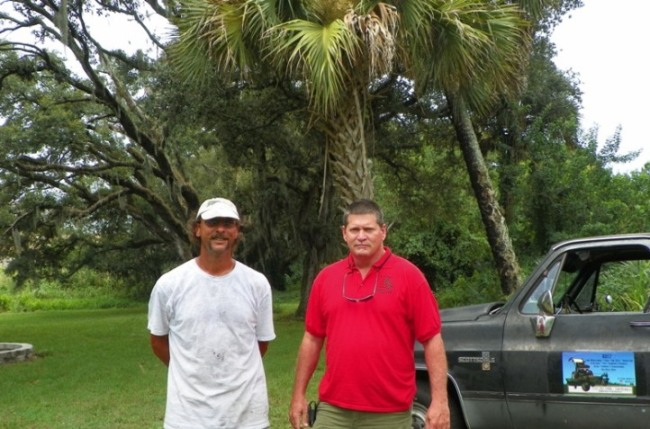 Kutz owner Tom Kennell (left) and St. Lucie County Scouts Inc(SLCS)/Camp Ahbaluf