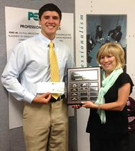 Jane Weiss of Perry Resources presents its 2012 scholarship to Robert Vogel