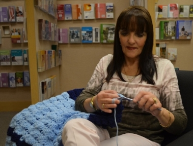 Valerie Johnson crochets a blanket for cancer patients.