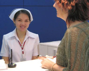 Medical tourist checking into Bangkok Hospital for surgery