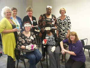 Maizie Mears-Owen with carers and nurses who attended the lecture at UCS