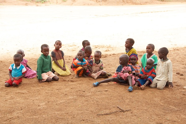 Samburu children shiver while doing school outside