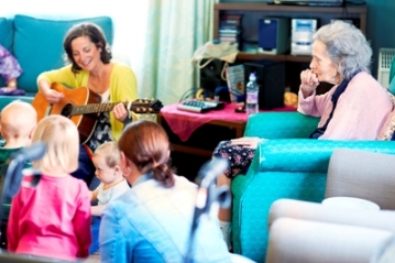 Residents, mums and toddlers enjoy the music at Colne View.