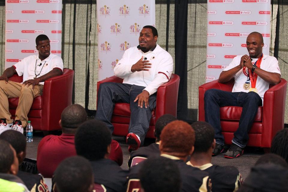 "Redskins NT Chris Baker and LaShawn Merritt (far right) at Redskins ""4th & Life"""