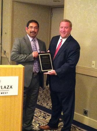 Thomas Thissen presents Gauher Mohammad with appreciation award from MNRSA