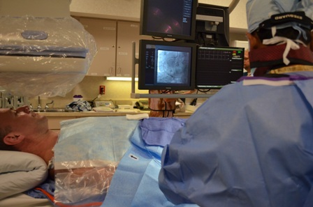 Interventional Cardiologist Dr. Bhavsar simulates cardiac catheterization.