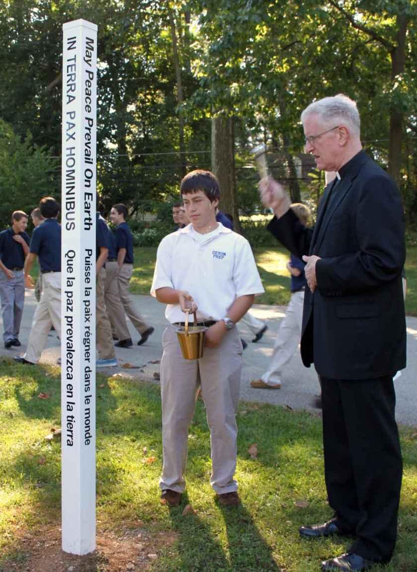 Devon Prep Headmaster, Rev. James Shea, Sch.P. (right) with Junior Sean Bevan.