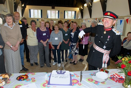 Lord Lieutenant cuts cake small