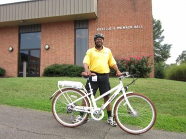 Security Guard Danny Anthony keeps watch over campus on Pedego electric bike.