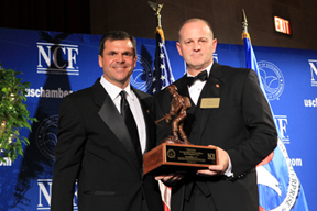 RecruitMilitary President Drew Myers, right, receives award from U.S. Chamber.