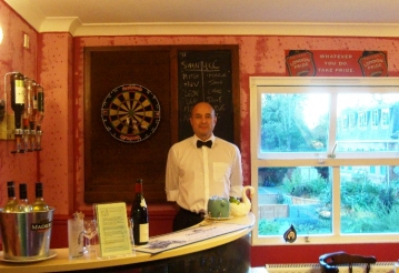 Care UK employee Michael Krasser behind the bar at Franklin House.