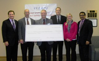 Riverland Community College accepts $20K check from Doherty Staffing Solutions.