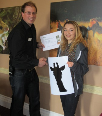 Emily Swettenham receives her award from Marwell
