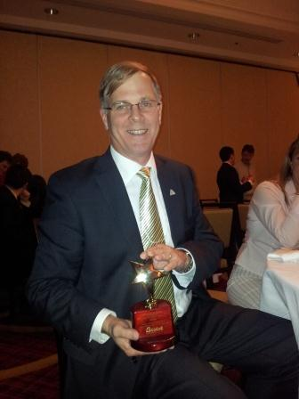 Sylvain Allaire, VP Sales and Marketing with HR pros, shows the 1st place award