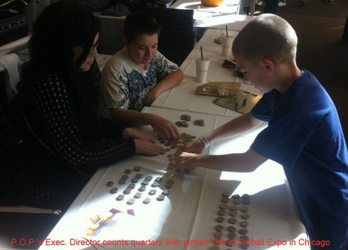 Counting quarters with pinball kids at Pinball Expo Chicago