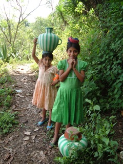 Guatemalan children carrying water