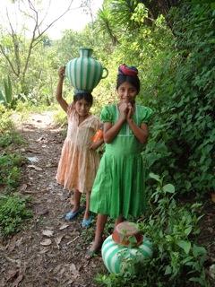 Guatemalan children carrying water