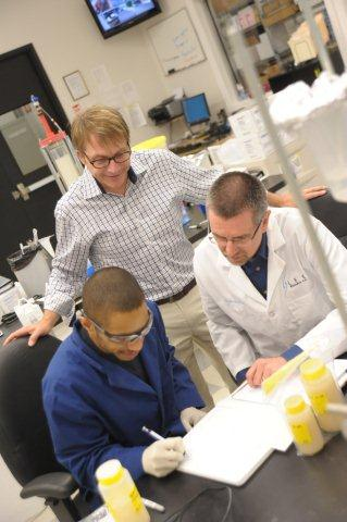 Scientific Team Reviewing Data from Tumor Marker Purification