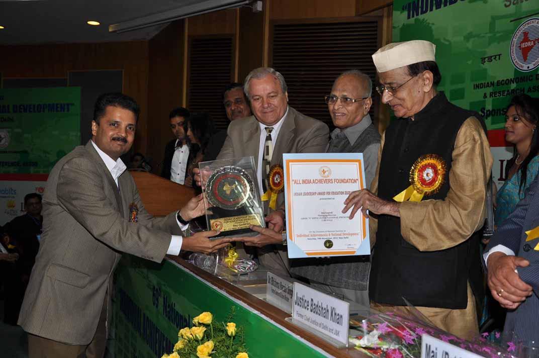 Mr. Raj Ganesh receiving the award from Former Governor Dr. Bhishma Narain Singh