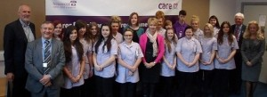 Teachers and students at Musselburgh Grammar School alongside Care UK employees.