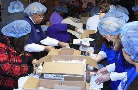 2011 Ford Volunteers pack meals for program