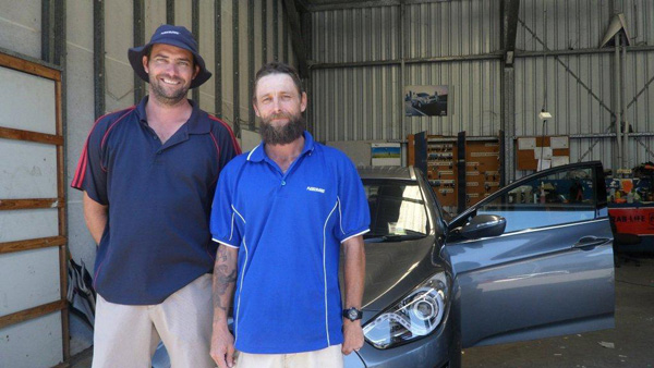 Adam Bepole and new employee Leigh Billman at Pickerings Auto, Townsville