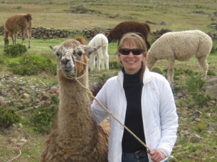 Diane Valenti with Llama friends in Puno, Peru