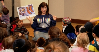 Jackie Oppenheimer leads a Hanukkah Storytelling session at the 2011 event