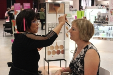 Breast cancer survivor Gladys Thomas receives a complimentary make-over.