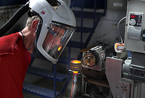 An EFD Induction engineer tests the brazing solution developed for Ekornes.