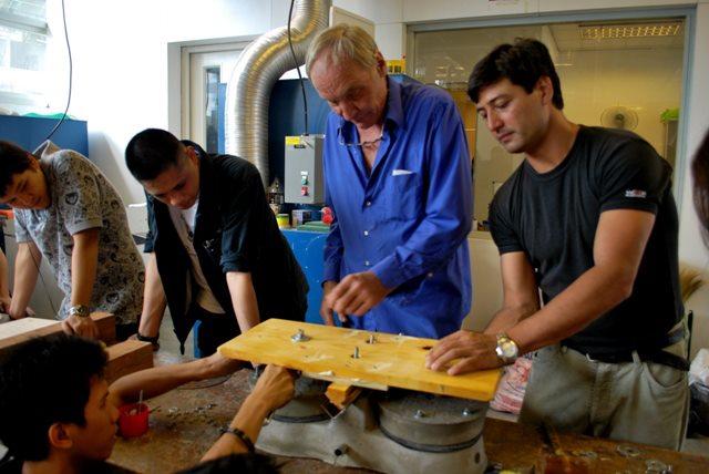 Jock Brandis & Illac Diaz work on a sustainable water pump.