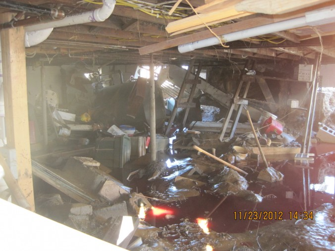 Heating oil was covering the water's surface in the basement