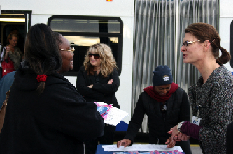 RTC representative, Michele Klimek (right), greets transit riders at the BTC