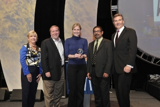 In this photo, VP Gauher Mohammad accepts ASA Care Award for Corporate Social