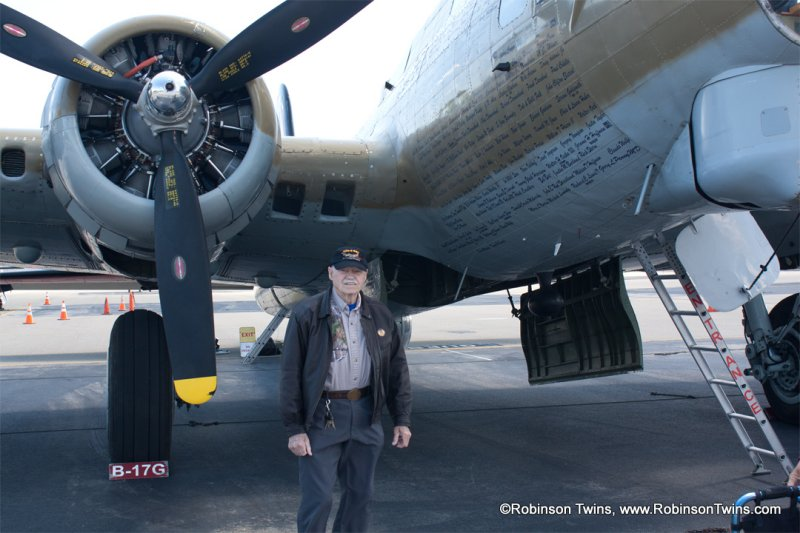 Ralph Wood standing by 9-0-9 B-17 bomber at Livermore.