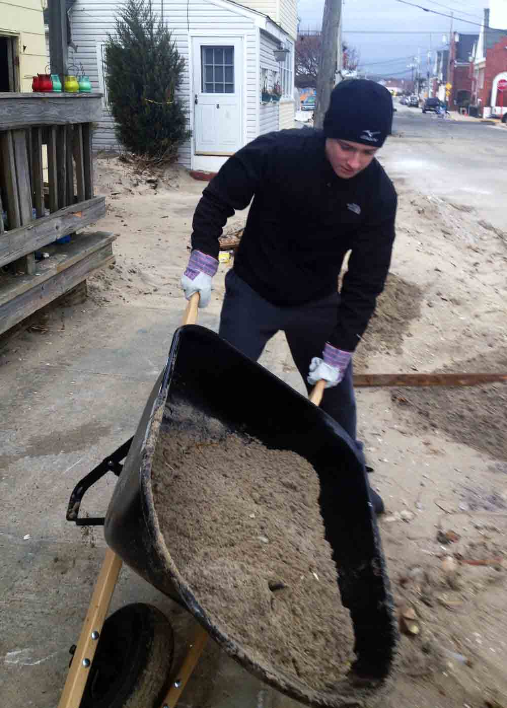 Devon Prep Student Michael Knudson spent all day clearing sand in Sea Bright, NJ