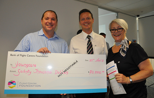 David Conry from Youngcare holding the cheque