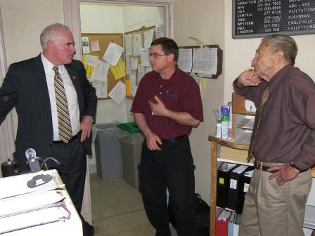 Congressman Pat Meehan (left) talks with MCES staff.