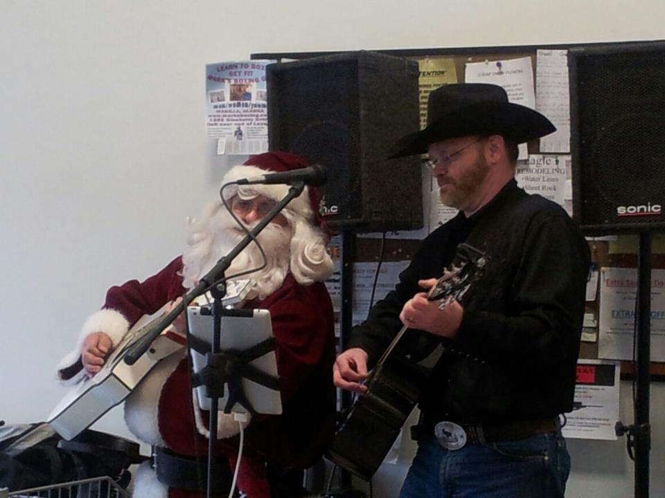 Doug Briney Performing With Santa Claus, Last Month