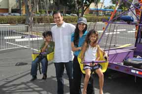 Drs. Niranjan and Lata Shintre with their children were in the swing of things.