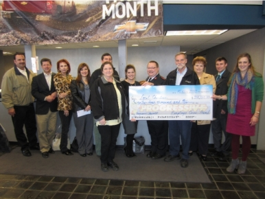 Check Presentation To Local Charities From Progressive Chevrolet Employees