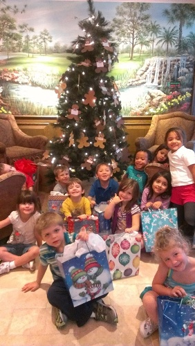 Child Care of SWF children receive gifts from Fiddlesticks Ladies Golf Assoc.