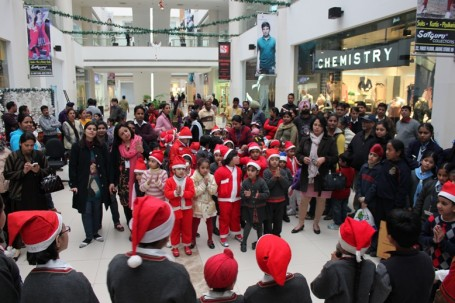 Carol Singing by 120 school kids at AlphaOne