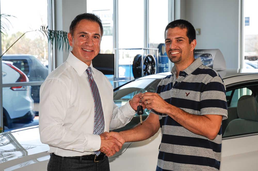 John Marazzi hands Kevin Rocha the keys to his new 2013 Honda Accord