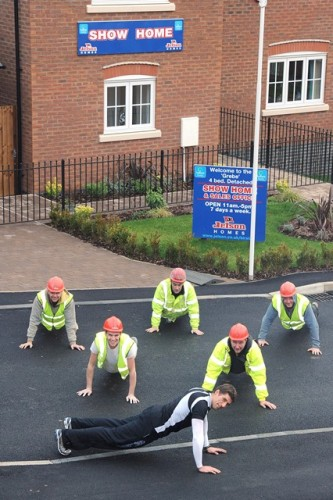 Nick Jelley and a group of builders stretch it out.