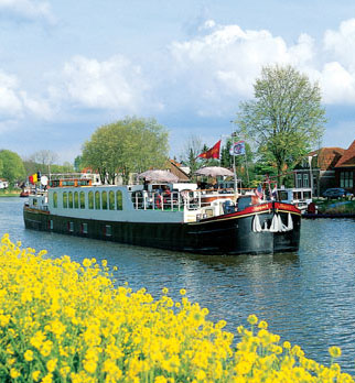 Luxury barge Panache cruises past flower fields of Holland