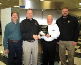 Roy Siegel presents the ACityDiscount team with Dealer of the Year Award