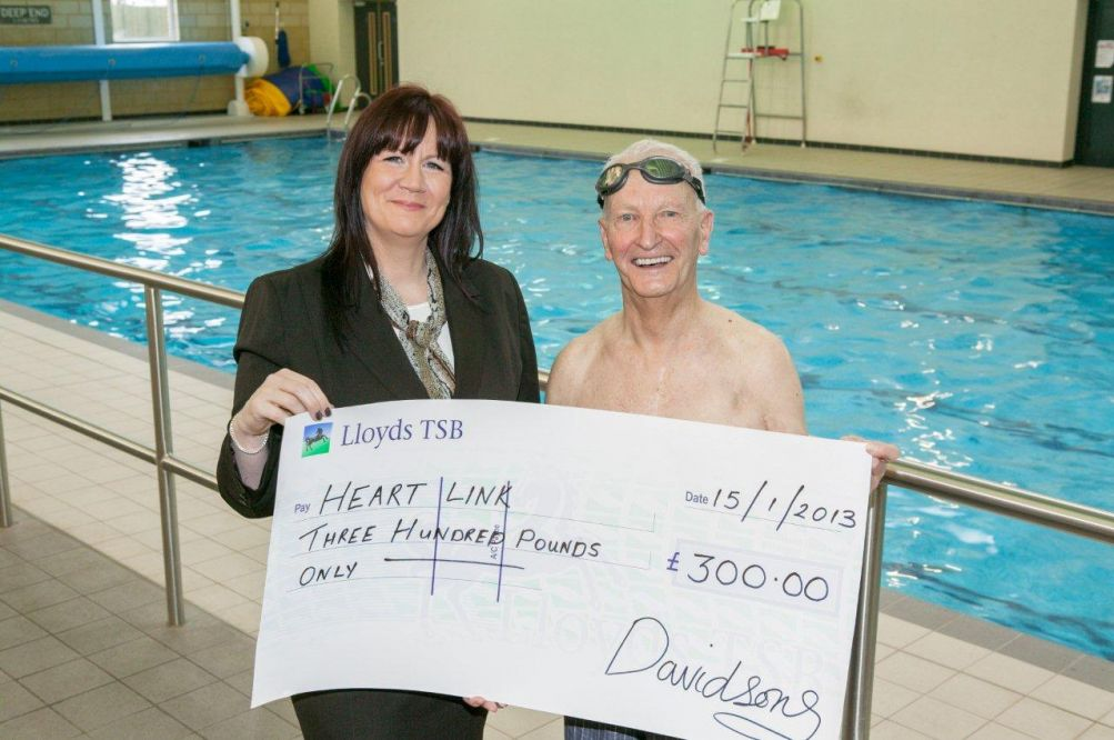 Stephanie King of Davidsons presents a cheque to Wilf Smith