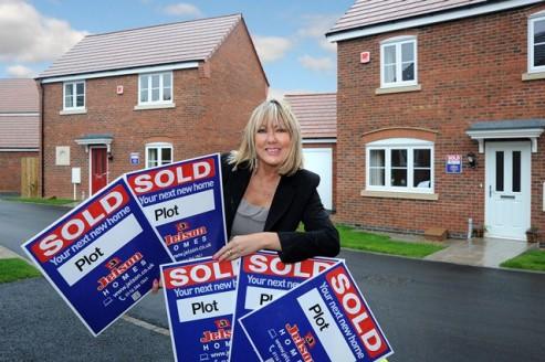 Sales adviser Sue Bates celebrates success at Grange Vale